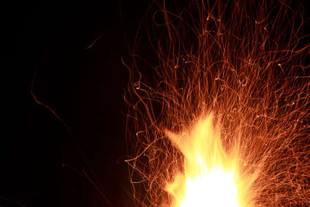 Abstract of spark and flame on black background photo