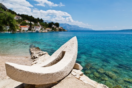 breakwaters: White Boat and Azure Adriatic Bay