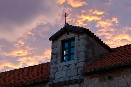 Dormer Window and Dramatic Sky Stock Photo - 10436752