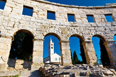 Ancient Roman Amphitheater and Church in Pula, Croatia photo