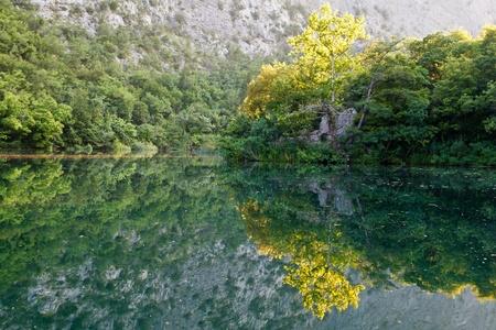 Beautiful Reflection on the River near Split, Croatia photo