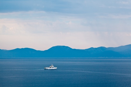 marvellous: Boat Passing Island of Brac in the Rainy Morning, Croatia