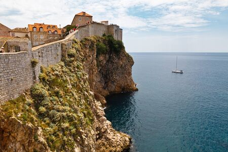 impregnable: Yacht Approaching Impregnable Walls of Dubrovnik, Croatia Stock Photo