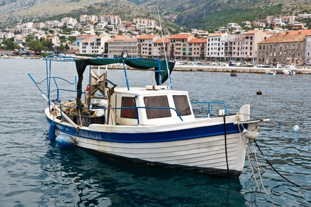 fisherman on boat: Fisherman Boat Docked at Harbor in Senj, Croatia