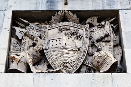 Shield, Helmets and Sword Marble Relief in Genoa, Italy photo