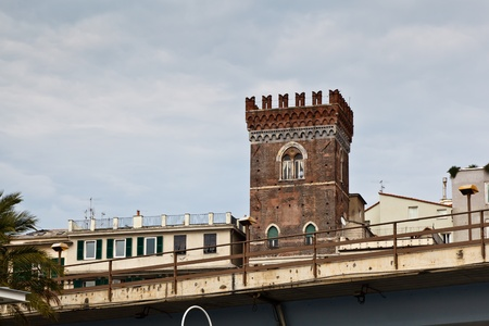 Red Defensive Tower in Genoa, Italy photo