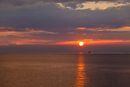 Lonely Ship and Beautiful Sunset near Genoa in Italy photo