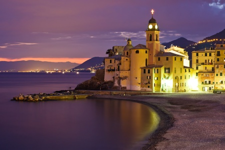 Beautiful Sunset on the Pebble Beach in Camogli near Genoa, Italy photo
