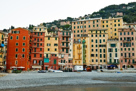 Colorful Facades of Houses on the beach of Camogli, Italy photo