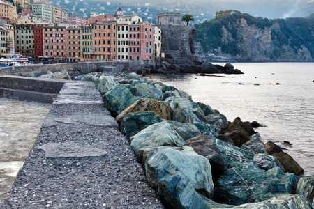 Breakwater with Huge Rocks in the Village of Camogli, Italy photo