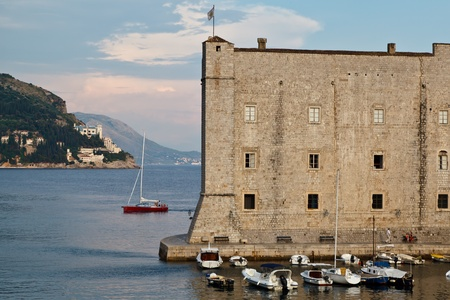Yacht Sailing behind Fort of Saint John in Dubrovnik, Croatia photo