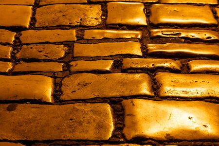 Illuminated Golden Cobblestones of Rovinj, Croatia photo
