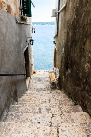 Narrow Stairway to Sea in Rovinj, Croatia photo