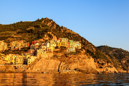 mediterranean house: Sunset in the Village of Manarola in Cinque Terre, Italy Stock Photo