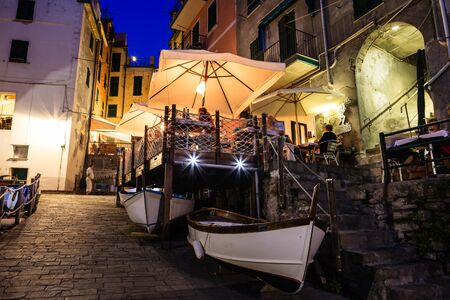 Illuminated Street of Riomaggiore in Cinque Terre at Night, Italy Banco de Imagens