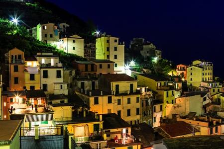 Aerial View on Illuminated Village of  Riomaggiore at Night, Cinque Terre, Italy photo