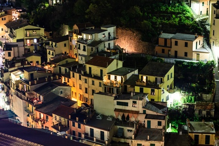 Aerial View on Illuminated Village of  Riomaggiore at Night, Cinque Terre, Italy photo