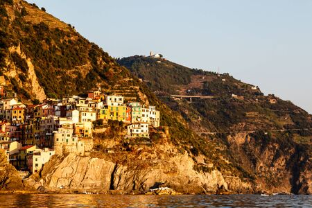 Sunset in the Village of Manarola in Cinque Terre, Italy photo