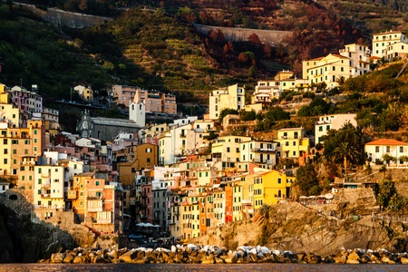 Sunset in the Village of Riomaggiore in Cinque Terre, Italy photo