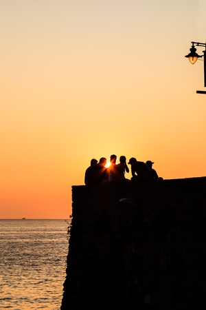 Group of People Watching Sunset in Riomaggiore, Italy Stock Photo - 13549701