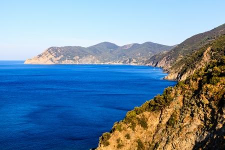The Wild and Rocky Coast near Village of Corniglia in Cinque Terre, Italy photo