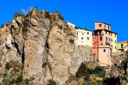 Houses High on the Cliff in the Village of Corniglia, Cinque Terre, Italy photo