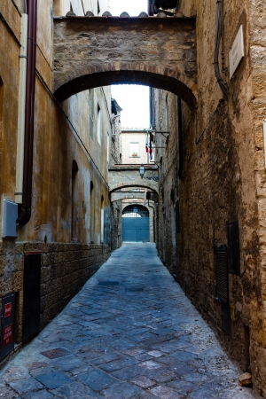 volterra: Narrow Street in the Town of Volterra in Tuscany, Italy Stock Photo