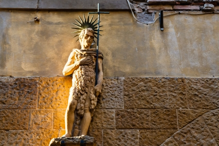 Statue on the House Facade in Volterra, Tuscany, Italy photo