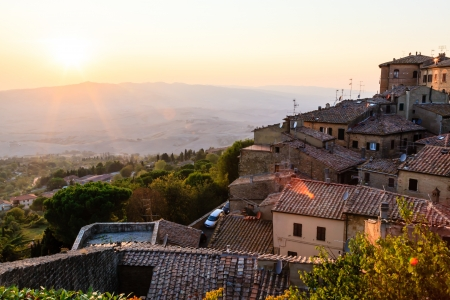 Sunset and Rays of Light in Small Town Volterra at Sunset in Tuscany, Italy