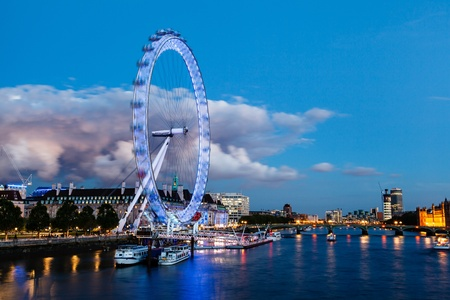 eye traveller: London Eye and Huge Cloud on London Cityscape in the Evening, United Kingdom