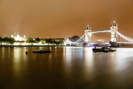Tower Brifge and Tower of London in the Rainy Night, United Kingdom photo