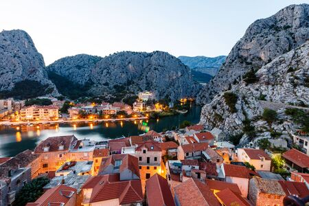 Aerial View on Illuminated Town of Omis in the Evening, Croatia photo