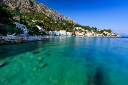 Beautiful Beach and Transparent Turquoise Adriatic Sea near Split, Croatia Editorial