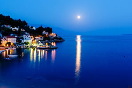Peaceful Croatian Village and Adriatic Bay Illuminated by Moon, Croatia