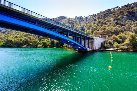 National Park Krka and Blue Bridge over the River near Town of Skradin, Croatia photo
