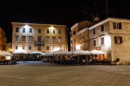 street lamps: Illuminated Downtown in the City of Pula at Night, Croatia Editorial