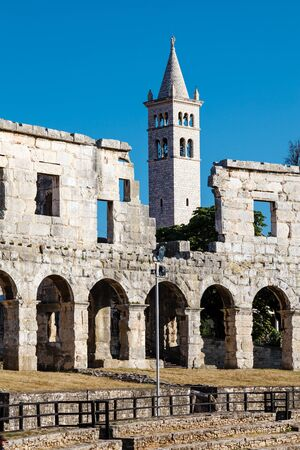 White Church and the Ancient Roman Amphitheater in Pula, Istria, Croatia photo