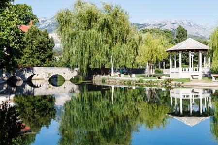 Picturesque Landscape, Stone Bridge, Pavilion, River and Willow, Solin, Croatia photo