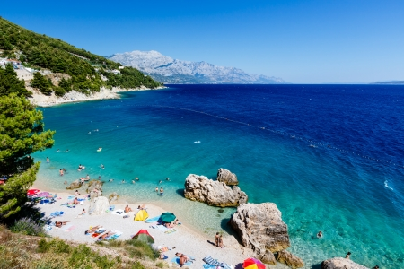 split: Beautiful Beach and Adriatic Sea with Transparent Blue Water near Split, Croatia