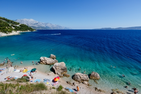 Beautiful Beach and Adriatic Sea with Transparent Blue Water near Split, Croatia photo