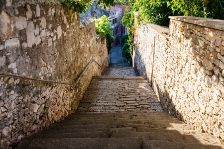 gravel roads: Narrow Street and Stairway in Pula, Croatia Stock Photo