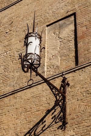 Old Iron Lantern in Siena, Tuscany, Italy photo