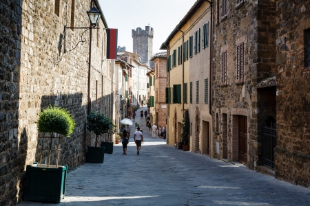 montalcino: Curved Street and Medieval Castle in Montalcino, Tuscany, Italy Stock Photo