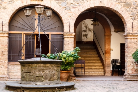 italian village: The Old Water Well in Montalcino, Tuscany, Italy Stock Photo