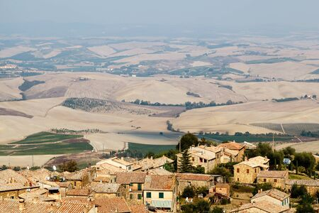 View of the Roofs and Landscape of a Small Town Montalcino in Tuscany, Italy photo