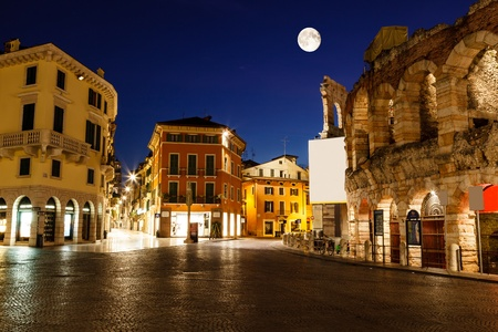 Full Moon above Piazza Bra and Ancient Roman Amphitheater in Verona, Italy Редакционное