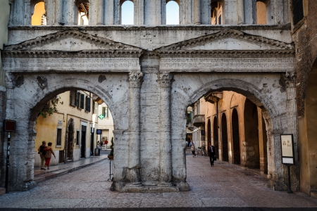 Ancient Roman Gate Porta Borsari in Verona, Veneto, Italy photo