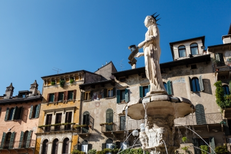 Fountain and Statue of Madonna on Piazza delle Erbe in Verona, Veneto, Italy Фото со стока