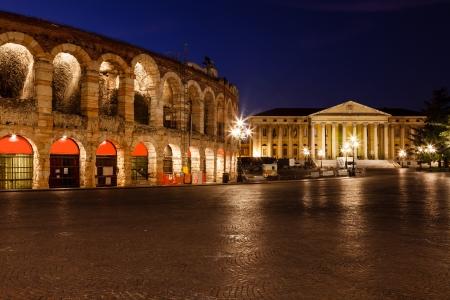 Illuminated Piazza Bra and Ancient Amphitheater in Verona, Veneto, Italy
