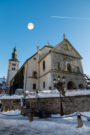 Full Moon above Medieval Church on the Central Square of Megeve, French Alps Stock Photo - 16108639